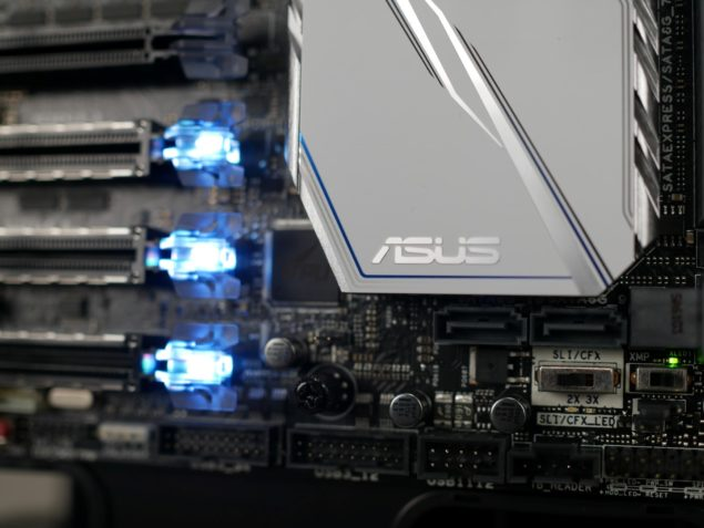ASUS X99 DELUXE II - dual front USB 3 & close up of PCIe SafeSlots & SLI & CF & XMP switches