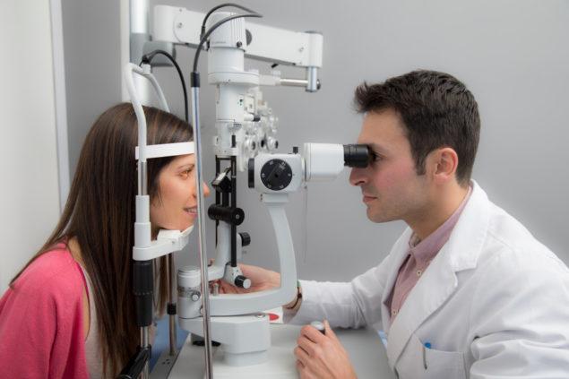 Woman at the optometrist making an eye test