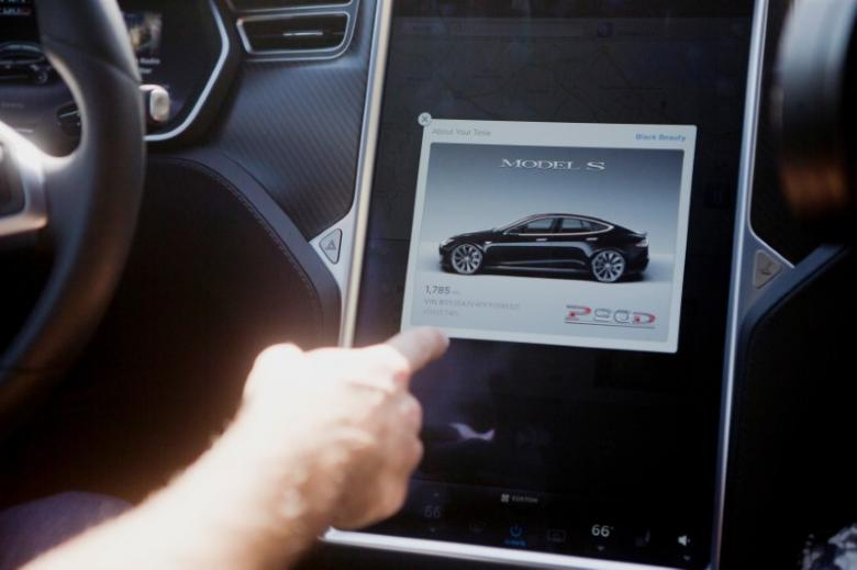The Tesla Model S version 7.0 software update containing Autopilot features is demonstrated during a Tesla event in Palo Alto
