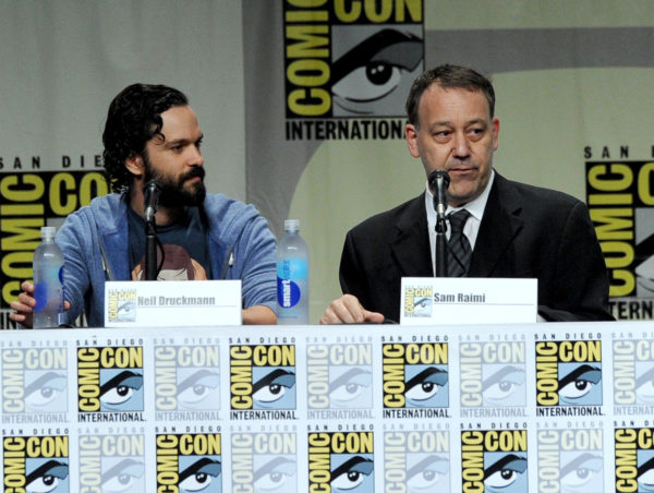 Neil Druckmann and Sam Raimi during a surprise appearance at Comic-Con 2014 (Photo by Kevin Winter/Getty Images)