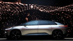 a-faraday-future-ff-91-electric-car-is-displayed-on-stage-during-an-unveiling-event-at-ces-in-las-vegas