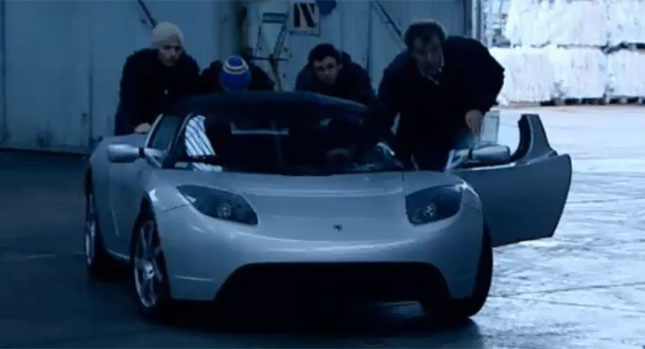 The Top Gear crew push a Tesla Roadster back for juice.