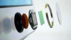 the-exploded-view-of-the-home-button-which-doubles-as-a-fingerprint-sensor-is-seen-on-an-image-of-the-new-iphone-5s-at-apple-incs-media-event-in-cupertino