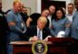 u-s-president-donald-trump-signs-a-presidential-proclamation-placing-tariffs-on-steel-and-aluminum-imports-while-surrounded-by-workers-from-the-steel-and-aluminum-industries-at-the-white-house-in-was