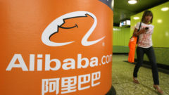 a-pedestrian-walks-past-alibaba-com-adve
