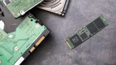 modern-m-2-ssd-drive-and-old-hard-disk-drives-lie-on-a-stone-slab